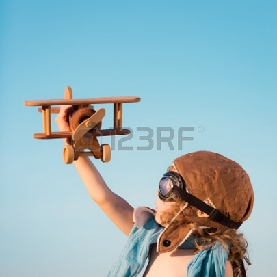19761822-happy-kid-playing-with-toy-airplane-against-blue-summer-sky-background